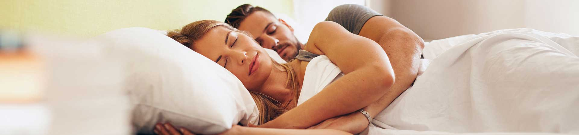 Man and woman sleeping
